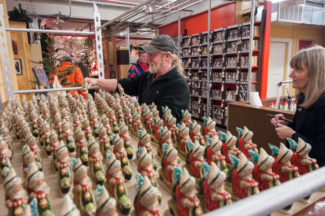 A collector takes time to choose his Starlight Santa before having it signed by Judi.