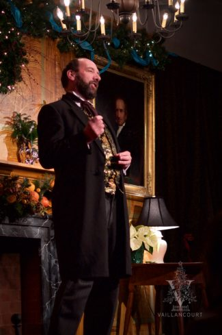 The great-great grandson of Charles Dickens, Gerald Charles Dickens, seen standing in Victorian garb on the stage at Vaillancourt Folk Art during a performance of A Christmas Carol.